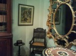 Rare 17th century Ceylon/South India ebony armchair,  from Longleat, with ebony tripod table and Ernst Agerbeek pastel of Dayak girl