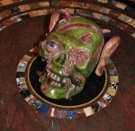 Jake and Dinos Chapman bronze painted skull on Regency pietra dura table