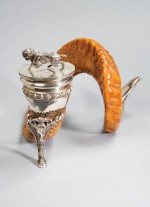 A single ram's horn, mounted as an inkwell in silver. Made by Walker & Hall, Sheffield, 1911.