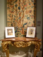 Julie Cockburn images on carved German side table in front of Crewelwork panel